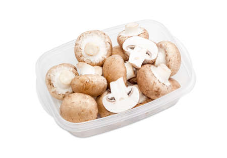 button mushroom: Fresh uncooked button mushrooms in a transparent plastic tray on a light background Stock Photo