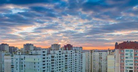 housing estate: Panorama of a sunset over the housing estate with modern multi-storey apartment buildings in a big city Stock Photo