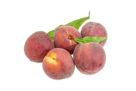 fuzz: Several ripe fresh peaches with leaves on a light background