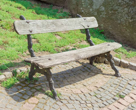 garden bench: Garden bench with old wooden planks in the park in summer day Stock Photo