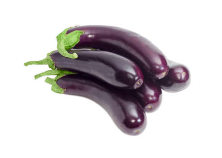 Pile of a ripe purple eggplants on a light background 스톡 콘텐츠