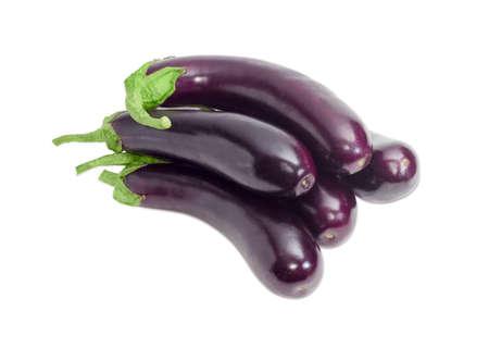 Pile of a ripe purple eggplants on a light background Standard-Bild