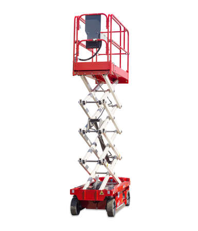 Mobile aerial work platform - red and white scissor hydraulic self propelled lift on light background. Standard-Bild