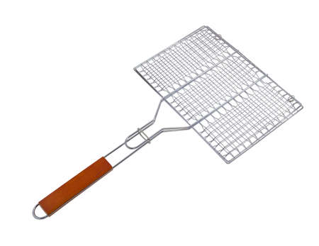 chromeplated: Steel grill grates with wooden handle on a light background