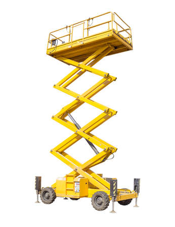 inaccessible: Mobile aerial work platform - yellow scissor hydraulic self propelled lift on a light background. Stock Photo
