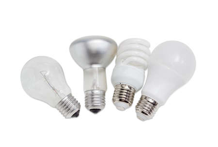 specular: Electric lamps of different types of electric lighting - incandescent lamp ordinary and lamp with specular coated of bulb, compact fluorescent lamp and light-emitting diode lamp on a light background