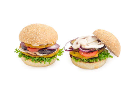 sesame street: Two vegetarian burger with filling of two lentil patties, lettuce, tomato, onion, eggplant, mushrooms and condiments on a light background