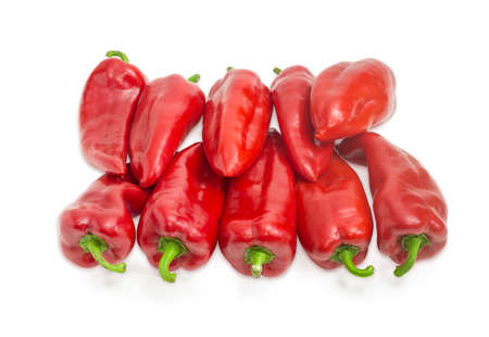 Pile of ripe sweet red Kapia peppers on a light background Stock Photo