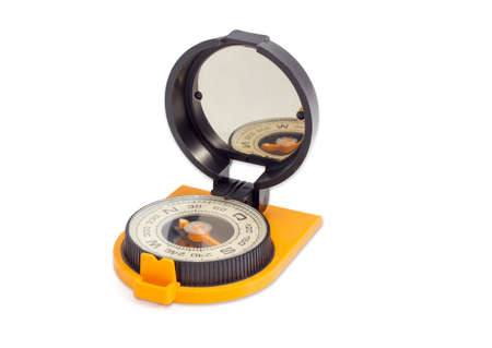 Dry magnetic tourist compass with mirror of sighting mechanisms on a light background Stock Photo