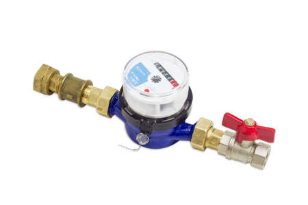 displacement: Not connected residential mechanical water meter for consumption measuring of a cold water with some plumbing components on a light background