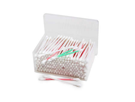aural: Cotton swabs on a white, red and green plastic rods in transparent rectangular plastic container and several cotton buds separately on a light background