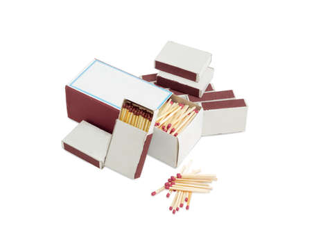 Household safety matches made from wood in one large and several small cardboard matchboxes and beside separately without box on a light background