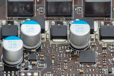 printed circuit: Fragment of printed circuit assembly with electronic components closeup Stock Photo
