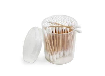 aural: Cotton swabs on a wooden rods in transparent round plastic container on a light background