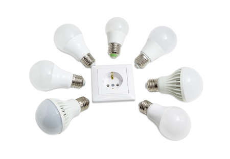 Several different domestic light emitting diode lamp with a sized E27 male screw base around the power socket on a light background Stock Photo
