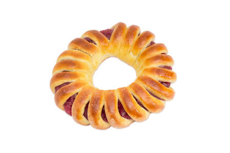 Pie with jam in the form of a ring, shaped like a bagel on a light background