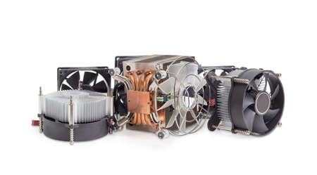Several different active CPU coolers and fans different sizes for a computer case on a light background  Stock Photo