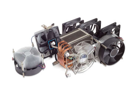 Several various active CPU coolers with fans and computer fans different sizes for use in a computer case on a light background  Stock Photo