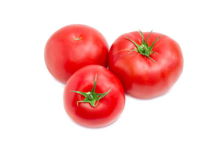 Three ripe red tomatoes closeup on a light background  Stock Photo
