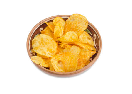 Potato chip flavored paprika in the ceramic bowl on a light background