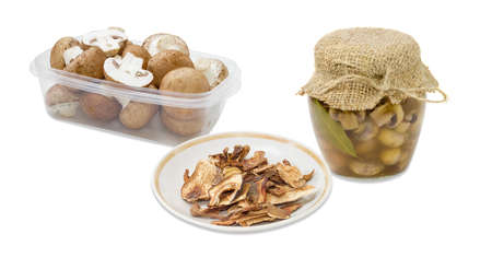 Dried boletus, pickled button mushrooms in glass jar, fresh uncooked button mushrooms in a transparent plastic tray on a light background