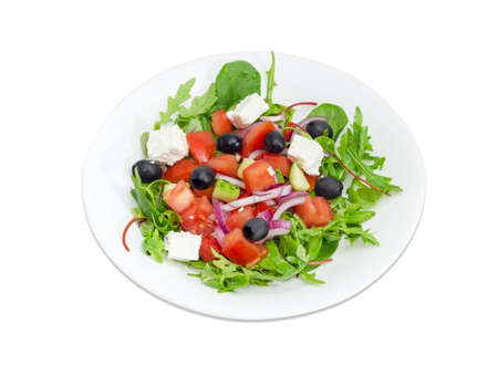 Greek salad in a white dish on a white background  Stock Photo