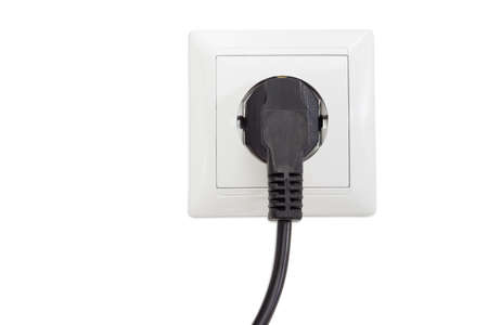 socket outlet: White socket outlet European standard with connected corresponding black AC power plug closeup on a light background