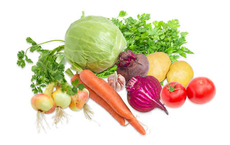 potherb: Pile of different raw vegetables and potherb, like white cabbage, tomatoes, onion, garlic, potatoes, carrots, beetroot, parsley, cilantro,  required for a beet soup making on a light background Stock Photo