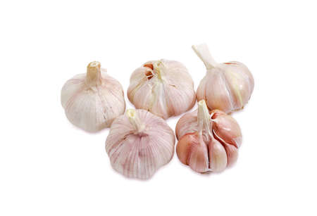 Several bulbs of the ripe garlic closeup on a light background