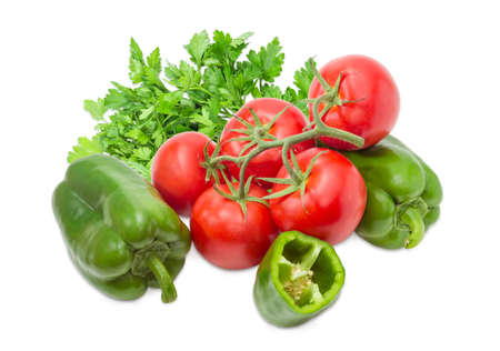 potherb: Branch with several ripe red tomatoes, two whole and one half of the green bell peppers and bundle of the parsley closeup on a light background Stock Photo