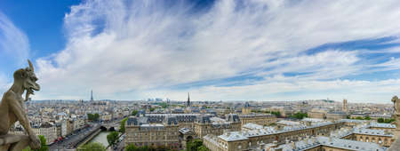 gargoyles: Panorama of northwestern part of Paris from the tower of the Cathedral Notre-Dame de Paris the background of sky with clouds in the springtime