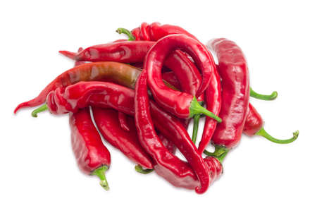 pungency: Pile of the fresh ripe red peppers chili on a light background