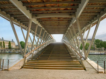 metallic stairs: Fragment of the footbridge over the River Seine in Paris on a spring afternoon