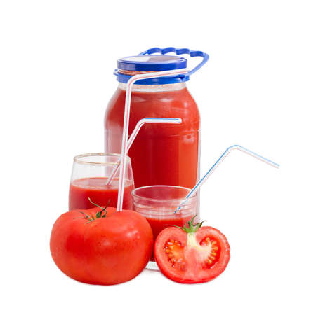 bendable: Big fresh whole tomato with bendable drinking straw inserted into it, half of the tomato, tomato juice in glass jar and in two different glasses with drinking straws on a light background Stock Photo
