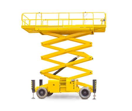 Yellow scissor wheeled lift on a light background