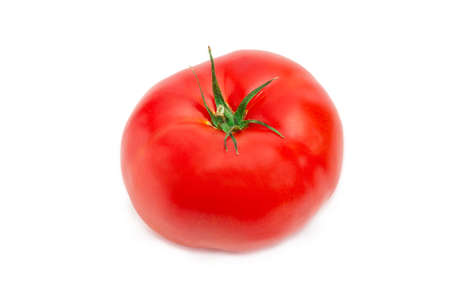 One big ripe red tomato closeup on a light background Imagens