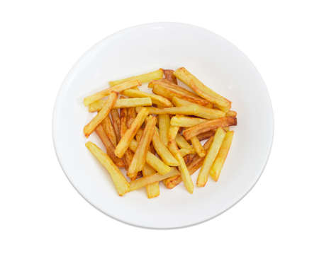 Top view of the serving of the French fries on the white dish on a light background Stock Photo