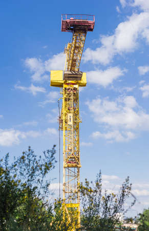latticed: Tower construction crane with latticed boom on a background of the sky