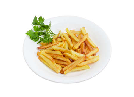 Serving of the French fries with twigs of the parsley on the white dish on a light background