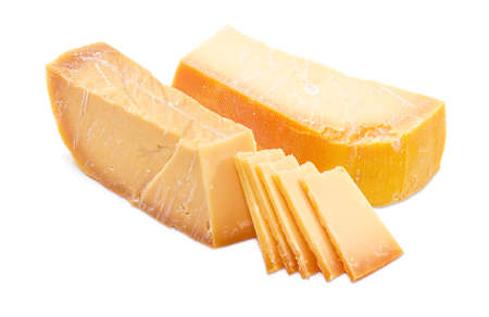 specific: Two pieces and several slices of the Dutch hard cheese Beemster closeup