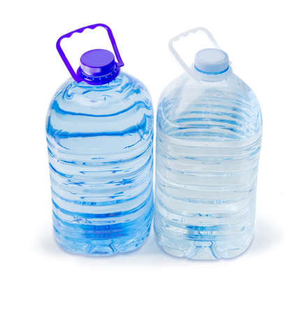One blue and one transparent large plastic bottles with carrying handles with drinking water on a white background Banco de Imagens