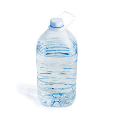 Drinking water in the large transparent plastic bottle with carrying handle on a white background