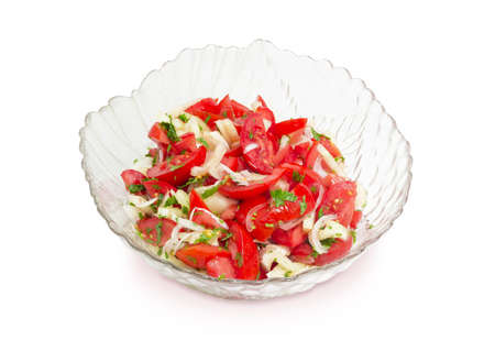 potherb: Vegetable salad of a fresh sliced tomatoes, white bell pepper, onion and potherb in a glass salad bowl on a white background
