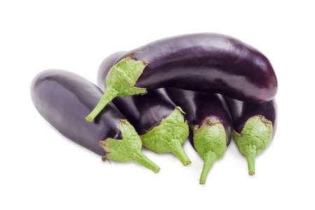 Pile of the fresh purple eggplants on a white background