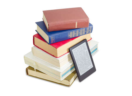 Ebook reader near of a stack of ordinary paper books on a white background Stok Fotoğraf