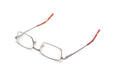 Modern pair of the classic mens eyeglasses in metal frame on a white background