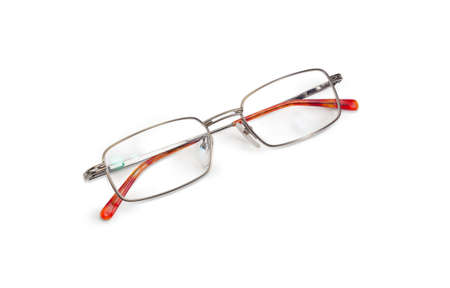 Modern pair of the classic mens eyeglasses in metal frame with folded glasses temples on a white background