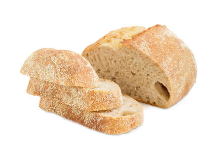 Several slices and half of loaf of the wheat sourdough hearth bread with bran on a white background Stock Photo