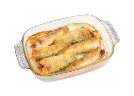 Baked carcasses of the notothenia fish in glass casserole dish