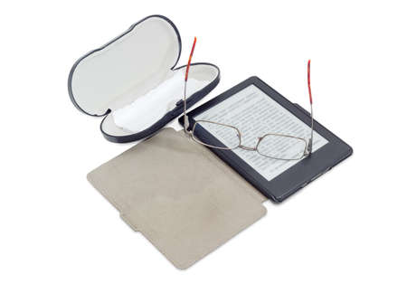 E-book reader in an open e-reader case, modern classic mens eyeglasses in metal frame and hard spectacle-case with wipes for glasses on a white background